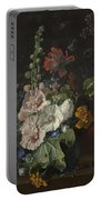 Hollyhocks And Other Flowers In A Vase Portable Battery Charger