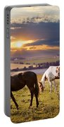 Horses Grazing At Sunset Portable Battery Charger