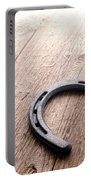 Horseshoe On Wood Floor Portable Battery Charger