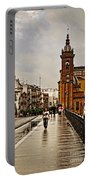In The Rain - Puente De Triana Portable Battery Charger