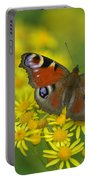 Inachis Io Butterfly On The Yellow Flowers Portable Battery Charger