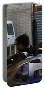 Indian Man Enjoying In A Bumper Cars Ride In An Entertainment Park Portable Battery Charger