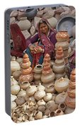 Indian Women Selling Pottery Portable Battery Charger