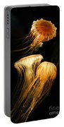 Jellyfish Trio Floating Against A Black Portable Battery Charger