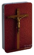 Jesus On Cross Against Red Wall Portable Battery Charger