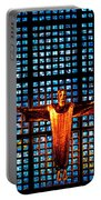 Jesus Sculpture And Blue Glass Background Portable Battery Charger