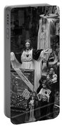 Jesus With Arms Wide Open Religious Figurines In A Shop Window In Toronto Portable Battery Charger