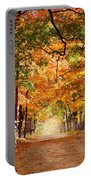 Kid With Backpack Walking In Fall Colors Portable Battery Charger