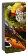 Koi Fish In Pond Swimming With Two Mallard Ducks Portable Battery Charger