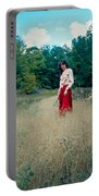 Lady Standing In Grass 2 Portable Battery Charger