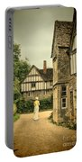 Lady Walking In The Village Portable Battery Charger by Jill Battaglia