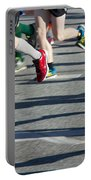 Legs Of Runners At Marathon Portable Battery Charger
