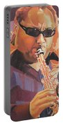 Leroi Moore Purple And Orange Portable Battery Charger