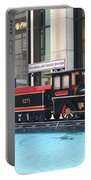 Life Size Toy Train Set In Nyc Portable Battery Charger