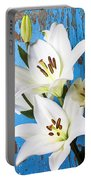 Lilies Against Blue Wall Portable Battery Charger