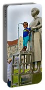 Little Girl Gets Close To Woman Sculpture In Donkin Reserve In Port Elizabeth-south Africa Portable Battery Charger