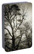 London Eye Through Snowy Trees Portable Battery Charger