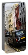 London Taxi On Shopping Street Portable Battery Charger