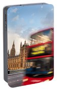 London The Uk Red Bus In Motion And Big Ben Portable Battery Charger