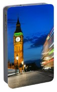 London Uk Red Bus In Motion And Big Ben At Night Portable Battery Charger