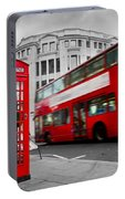 London Uk Red Phone Booth And Red Bus In Motion Portable Battery Charger