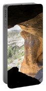 Looking Out Of A Cave Of Gila Dwellings Portable Battery Charger