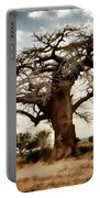 Luminous Sky And Tree Skeleton On The Prairie Portable Battery Charger