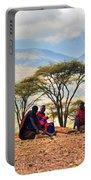 Maasai Men Sitting. Savannah Landscape In Tanzania Portable Battery Charger