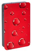 Macro Water Drop On Red Portable Battery Charger