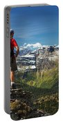 Male Hiker Standing On Top Of Mountain Portable Battery Charger