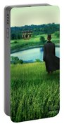 Man In Top Hat On A Hill Portable Battery Charger