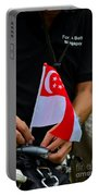 Man Plants Singapore Flag On Bicycle Portable Battery Charger