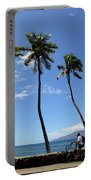 Man Riding Bicycle Beside Palm Trees Portable Battery Charger