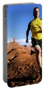 Man Running In Moab, Utah Portable Battery Charger