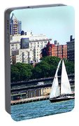 Manhattan - Sailboat Against Manhatten Skyline Portable Battery Charger