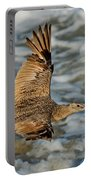 Marbled Godwit Flying Over Surf Portable Battery Charger
