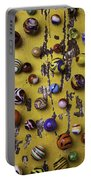 Marbles On Yellow Wooden Table Portable Battery Charger