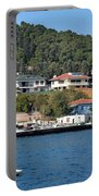 Marina Bay Scene With Boat And Houses On Hills Portable Battery Charger