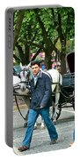 Men And Carriages In A Street Near Saint Sophia's In Istanbul-turkey Portable Battery Charger