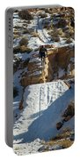 Mountain Biker Jumping With Snowy Portable Battery Charger