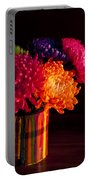 Multicolored Chrysanthemums In Paint Can On Chest Of Drawers Int Portable Battery Charger
