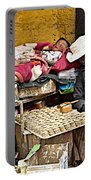 Nap Time For Child And Street Shopkeeper In Lhasa-tibet   Portable Battery Charger