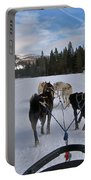 Riding Through The Colorado Snow On A Husky Pulled Sled Portable Battery Charger