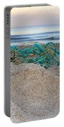 Old Fishing Net On Beach Portable Battery Charger