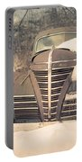 Old Plymouth Classic Car In The Snow Portable Battery Charger by Edward Fielding