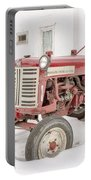 Old Red Tractor In The Snow Portable Battery Charger