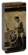 old sailor A vintage processed photo of a sailor sitted behind the rudder in Mediterranean sailing Portable Battery Charger
