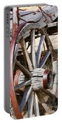 Old Wagon Wheels From Montana Portable Battery Charger by Jennie Marie Schell