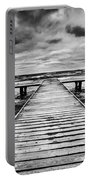 Old Wooden Jetty During Storm On The Sea Portable Battery Charger
