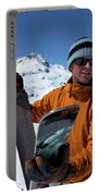 One Backcountry Skier Putting Skins Portable Battery Charger